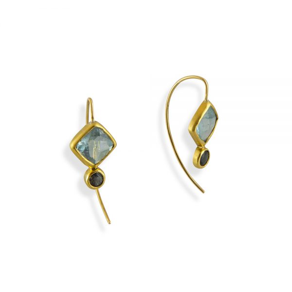 Aquamarines and Sapphires set in 18k yellow gold