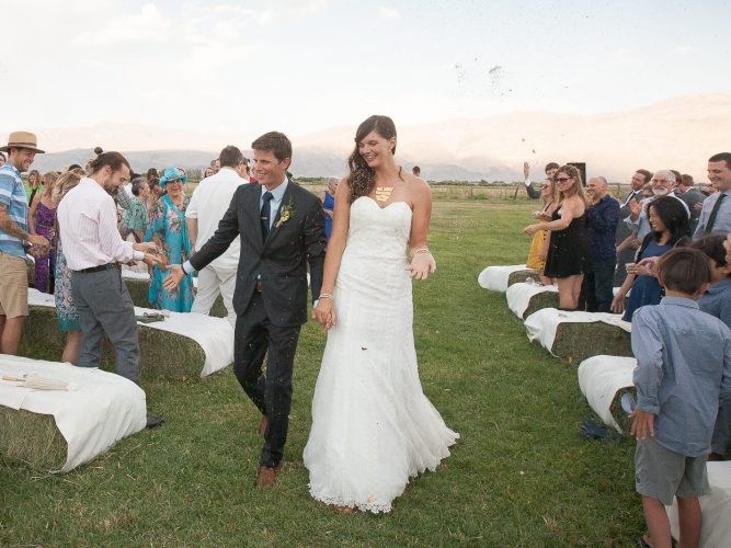 Bride and groom walking down aisle